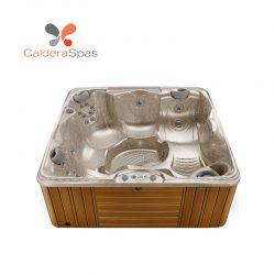 A Caldera Capitolo hot tub with a Desert shell and Teak siding.