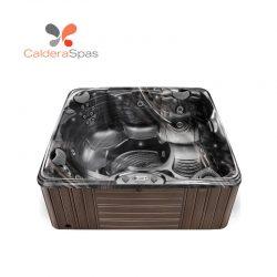A Caldera Capitolo hot tub with a Midnight Canyon shell and Espresso siding.