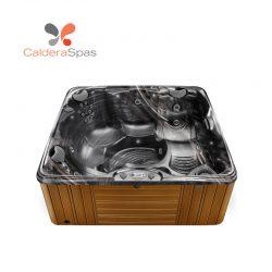 A Caldera Capitolo hot tub with a Midnight Canyon shell and Teak siding.