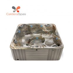 A Caldera Capitolo hot tub with a Tuscan Sun shell and Coastal Grey siding.