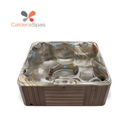 A Caldera Capitolo hot tub with a Tuscan Sun shell and Espresso siding.
