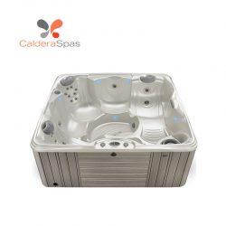 A Caldera Capitolo hot tub with a White Pearl shell and Coastal Grey siding.