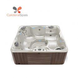 A Caldera Capitolo hot tub with a White Pearl shell and Espresso siding.
