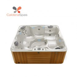 A Caldera Capitolo hot tub with a White Pearl shell and Teak siding.