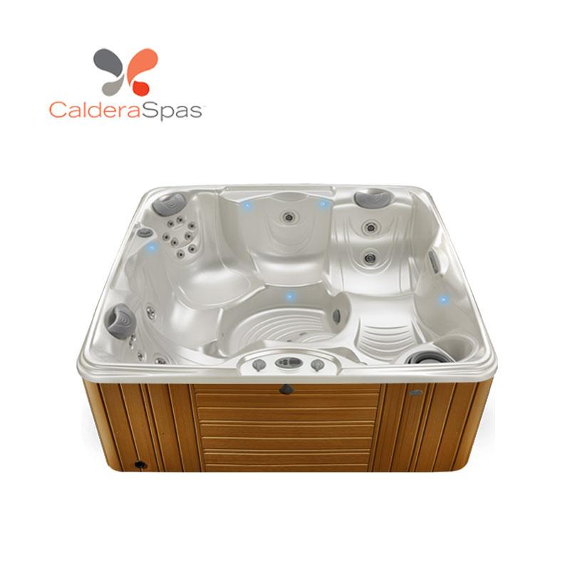 A Caldera Capitolo hot tub with a White Pearl shell and Teak siding.
