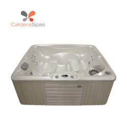 A Caldera Celio hot tub with a White Pearl shell and Coastal Grey siding.