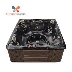 A Caldera Makena hot tub with a Midnight Canyon shell and Espresso siding.