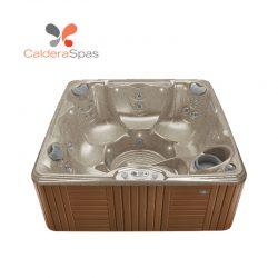 A Caldera Marino hot tub with a Desert shell and Teak siding.
