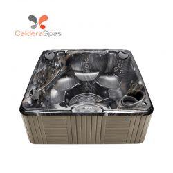 A Caldera Marino hot tub with a Midnight Canyon shell and Coastal Grey siding.