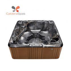 A Caldera Marino hot tub with a Midnight Canyon shell and Teak siding.