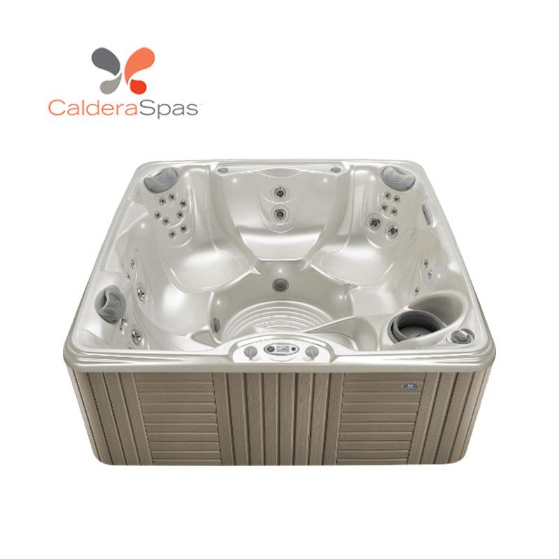 A Caldera Marino hot tub with a White Pearl shell and Coastal Grey siding.