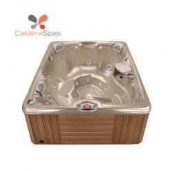 A Caldera Martinique hot tub with a Desert shell and Teak siding.