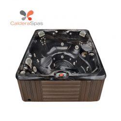 A Caldera Martinique hot tub with a Midnight Canyon shell and Espresso siding.