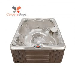 A Caldera Martinique hot tub with a White Pearl shell and Espresso siding.