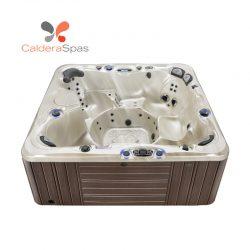A Caldera Niagara hot tub with a Champagne Opal shell and Espresso siding.