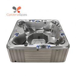 A Caldera Niagara hot tub with a Platinum shell and Coastal Grey siding.