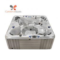 A Caldera Niagara hot tub with a Sterling Marble shell and Coastal Grey siding.