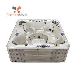 A Caldera Niagara hot tub with a White Pearl shell and Coastal Grey siding.