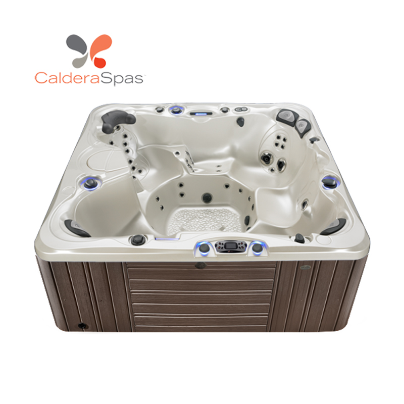 A Caldera Niagara hot tub with a White Pearl shell and Espresso siding.
