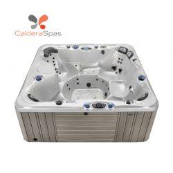 A Caldera Niagara hot tub with a White Sands shell and Coastal Grey siding.