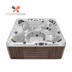 A Caldera Niagara hot tub with a White Sands shell and Espresso siding.